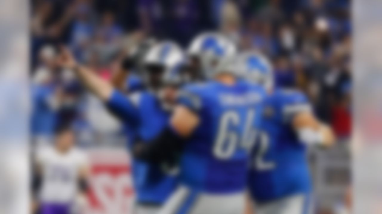 Detroit Lions kicker Matt Prater is congratulated by teammates after kicking a 40-yard game winning field goal during the second half of an NFL football game against the Minnesota Vikings, Thursday, Nov. 24, 2016 in Detroit. (AP Photo/Rick Osentoski)
