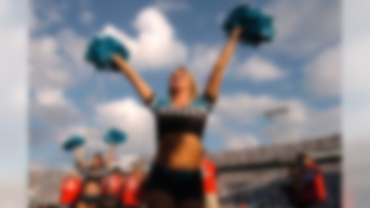 JACKSONVILLE, FL - DECEMBER 9:  A cheerleader for the Jacksonville Jaguars cheers against the Carolina Panthers at ALLTEL Stadium on December 9, 2007 in Jacksonville, Florida. The Jaguars defeated the Panthers 37-6. (Photo by Larry French/Getty Images)
