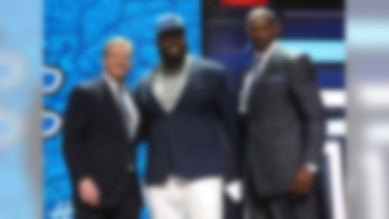 Alabama defensive tackle A'Shawn Robinson poses for a photo with NFL Commissioner Roger Goodell and former Detroit Lions player Herman Moore after being selected by the Detroit Lions during the 2016 NFL Draft at the Auditorium Theatre on Friday, April 29, 2016 in Chicago. (Perry Knotts/NFL)