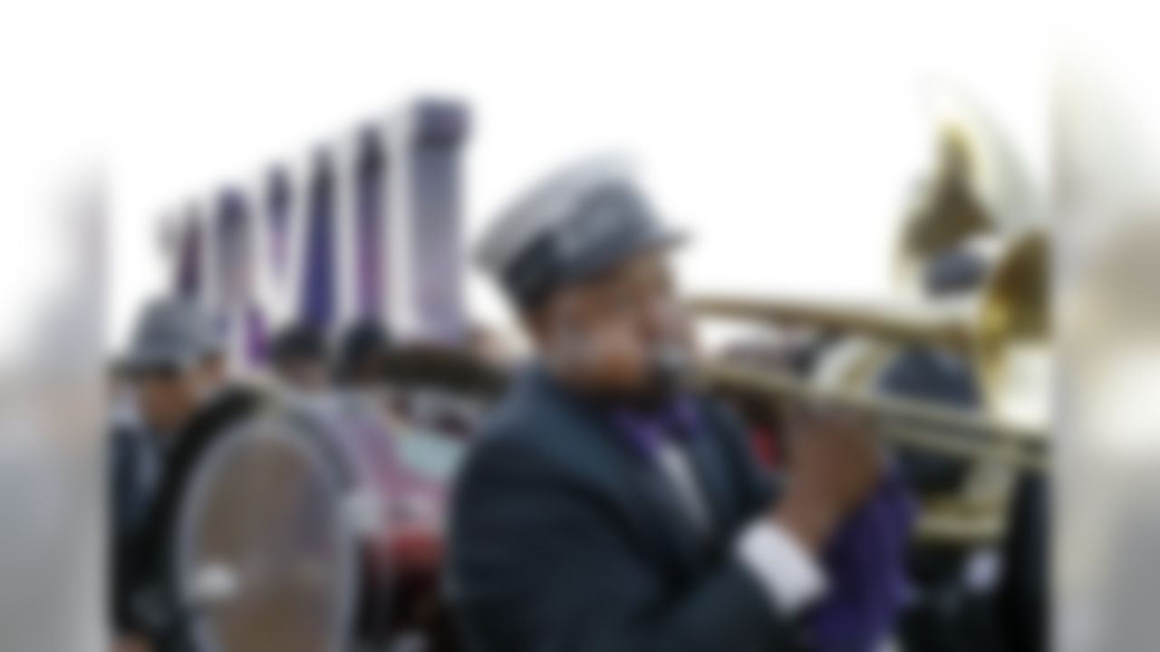 Richard Anderson, of New Orleans, plays the trombone as the Kinfolks Brass Band marches along the Riverwalk in New Orleans, Friday, Feb. 1, 2013. The Baltimore Ravens will play the San Francisco 49ers in the NFL football Super Bowl on Sunday. (AP Photo/Elise Amendola)