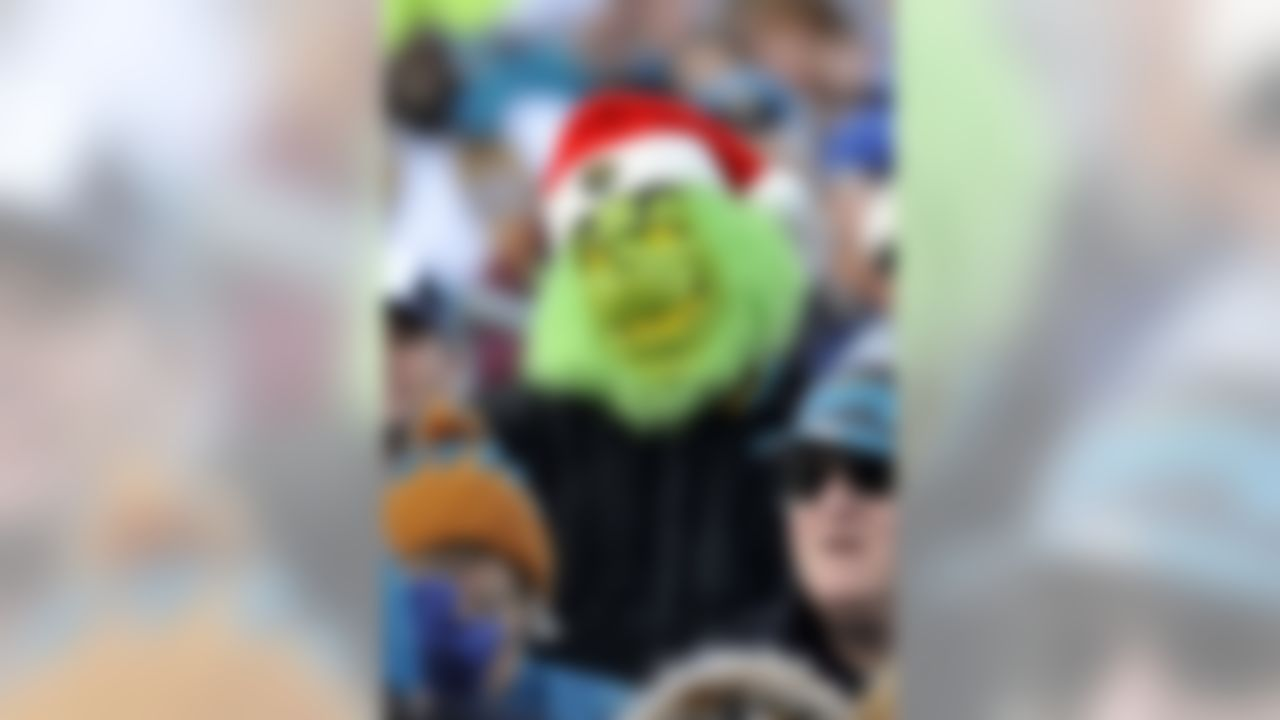 A Jacksonville Jaguars fan dressed as the Grinch watches his team play the Oakland Raiders during the second half of an NFL football game in Jacksonville, Fla., Sunday, Dec. 12, 2010. The Jaguars beat the Raiders 38-31. (AP Photo/Stephen Morton)