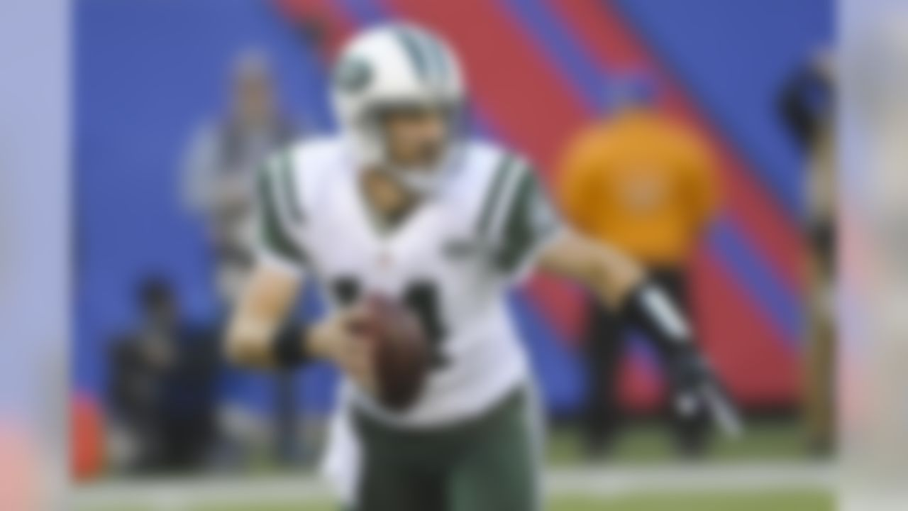 New York Jets quarterback Ryan Fitzpatrick (14) looks to pass during the first half of an NFL football game against the New York Giants Sunday, Dec. 6, 2015, in East Rutherford, N.J. (AP Photo/Bill Kostroun)
