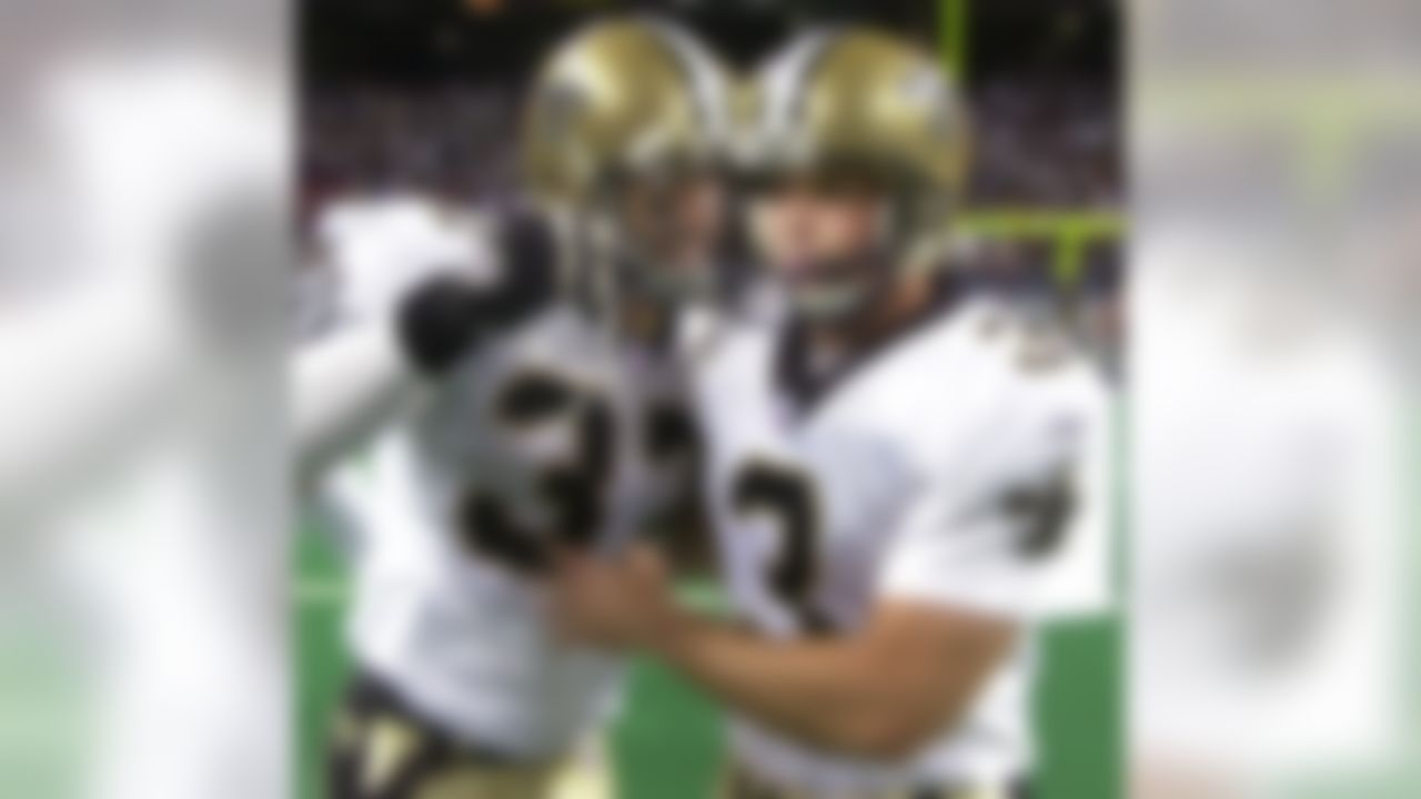 New Orleans Saints place kicker John Carney, right, is congratulated by safety Steve Gleason after Carney kicked the winning field goal in overtime against the St. Louis Rams in St. Louis, Sunday, Sept. 26, 2004. The Saints won, 28-25. (AP Photo/Charles Rex Arbogast)