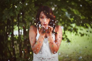Woman blowing glitters on her hands, © Oleg Magni