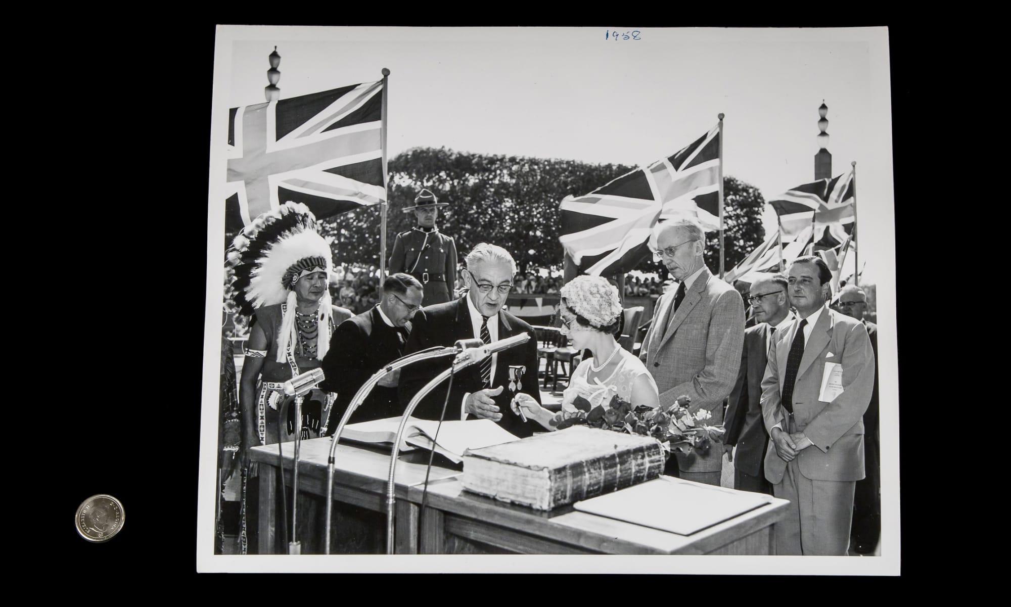 Princess Margaret signing a guest book in Niagara Falls