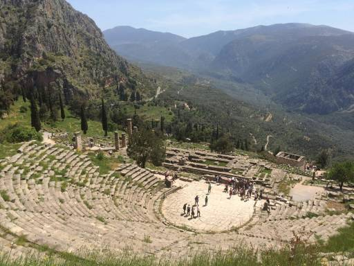 Ancient amphitheatre with mountains in the background