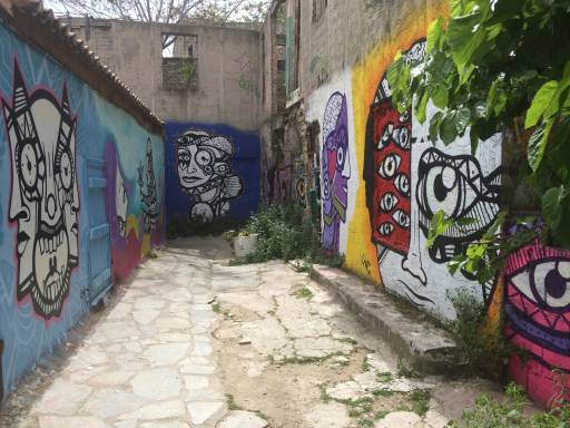 A worn-down alleyway brought to life with vibrant street art