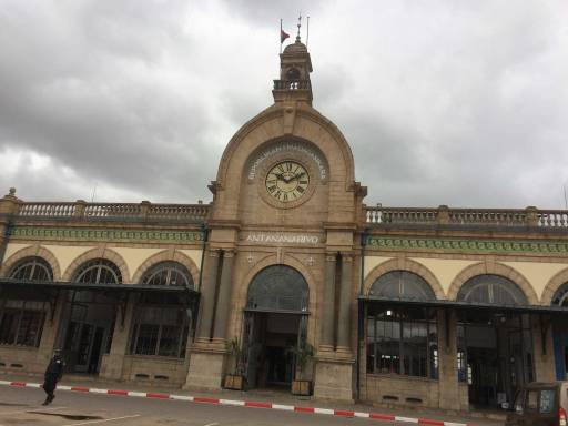 station facade with archways and a big clock