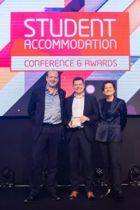 Nido Student collecting their student accommodation award