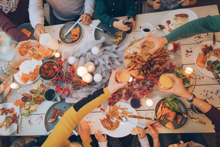 Group of student friends eating a Christmas meal together