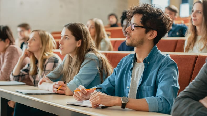 Students taking notes at a university lecture
