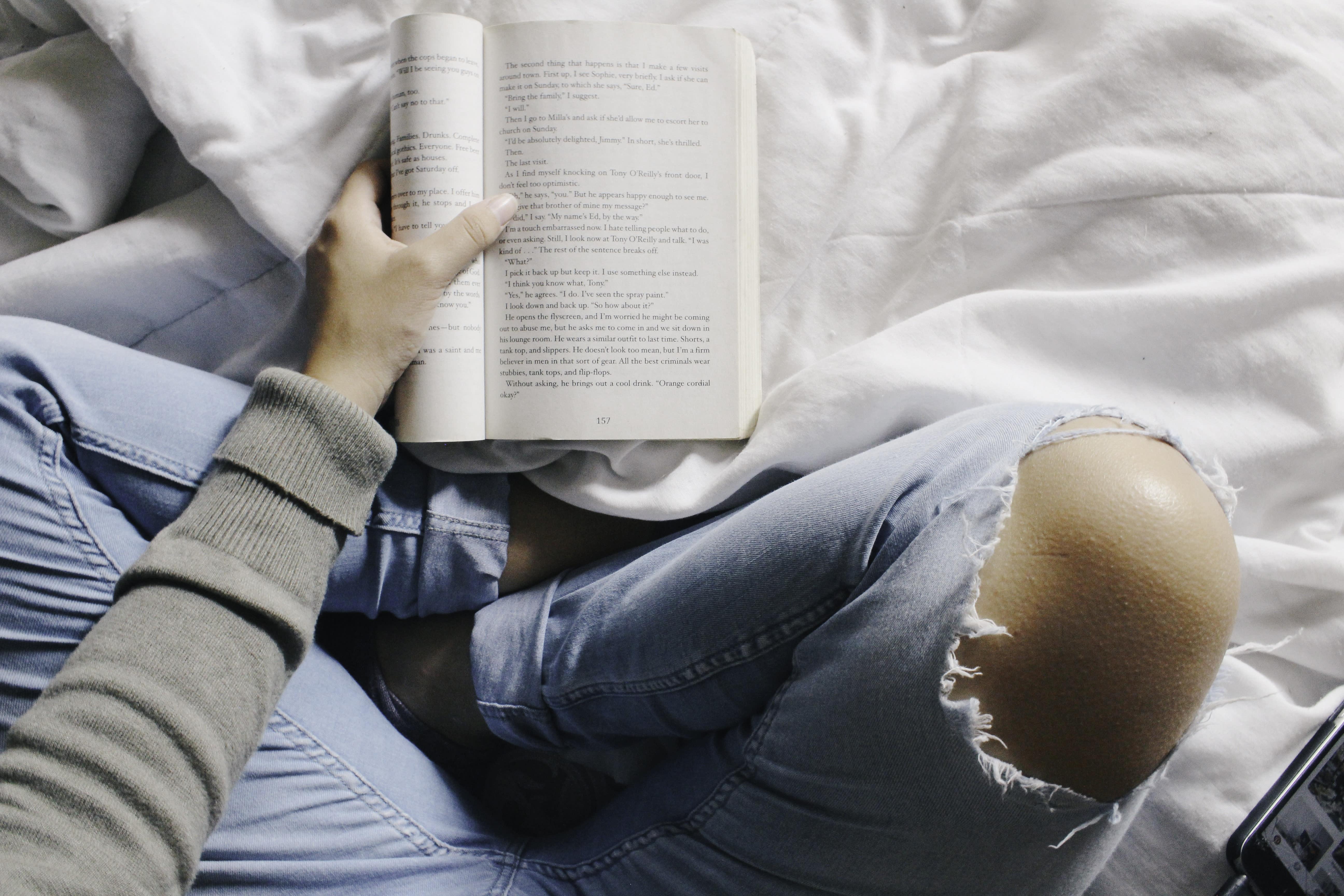 Woman crossing her legs reading