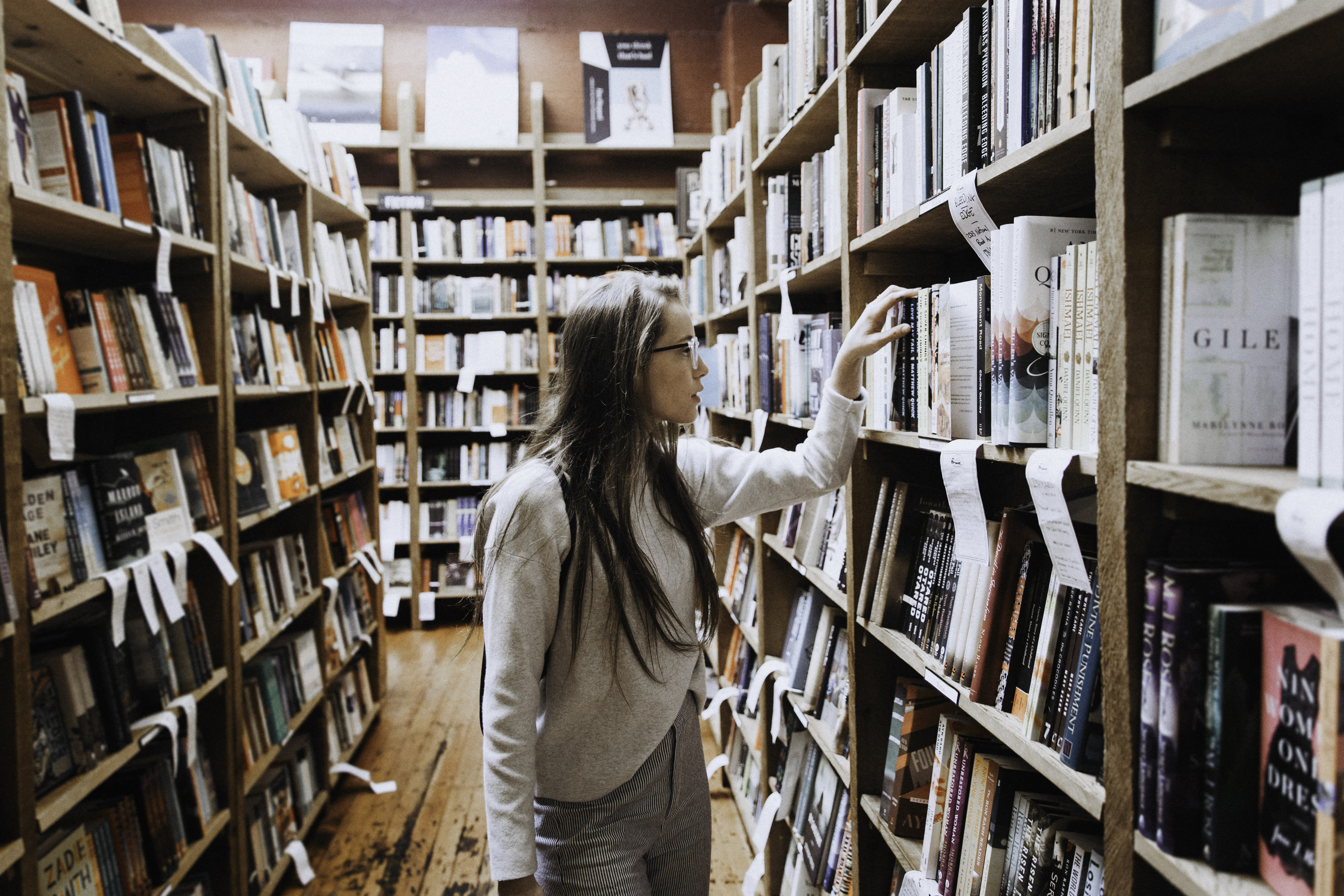 Girl in library looking at books