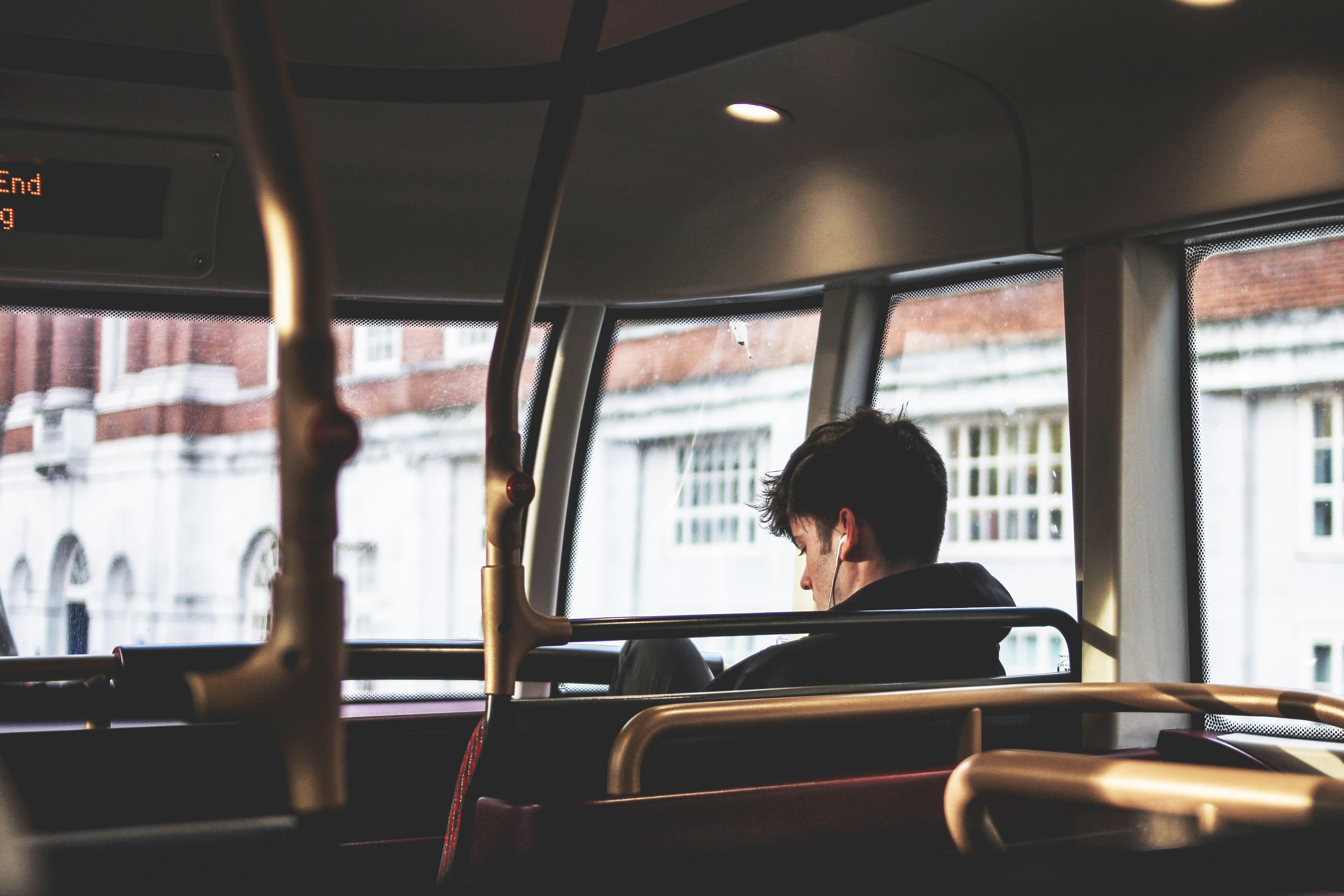 Boy on an empty bus