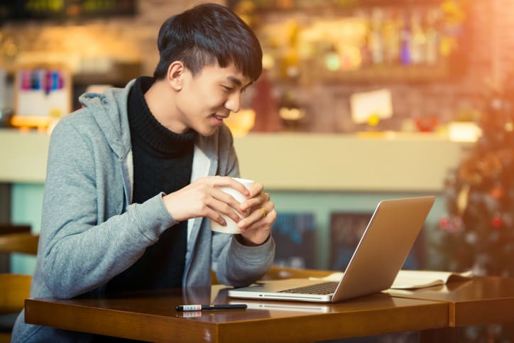 A young man in a coffee house