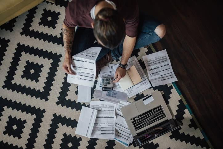 student calculating bills