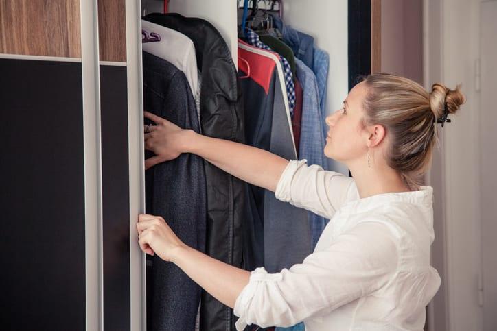 woman looking in wardrobe
