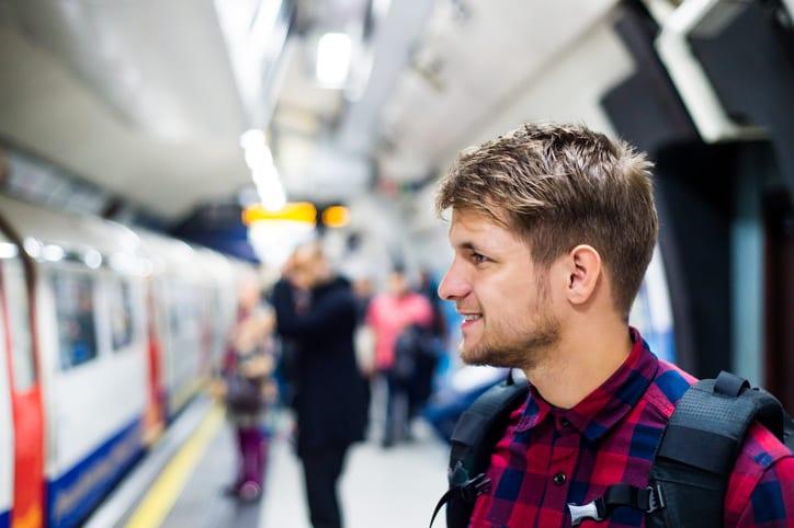 student on tube platform