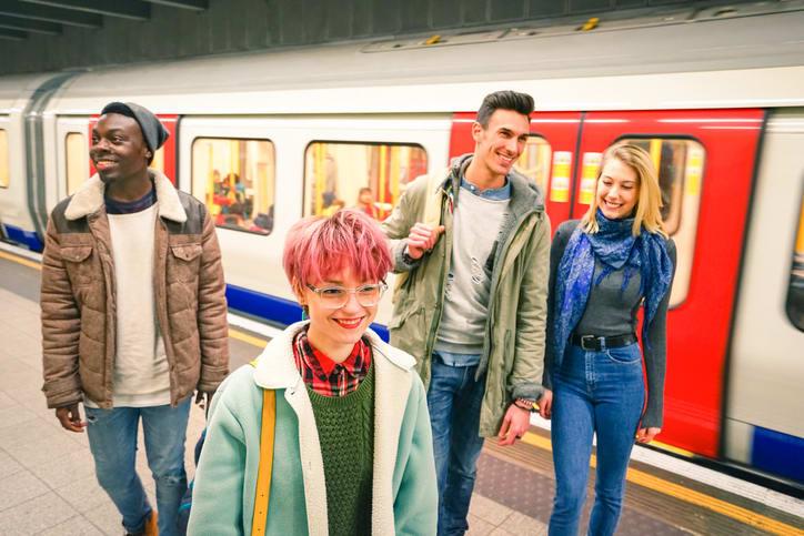students on tube platform