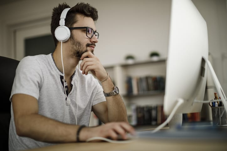 man studying listening to music