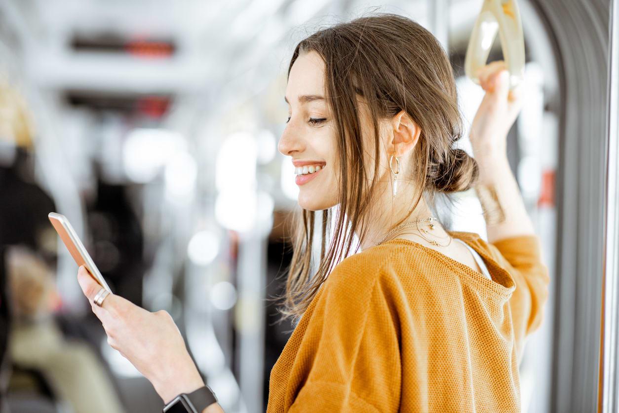 woman smiling at phone