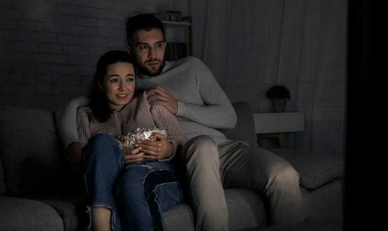 couple watching scary film