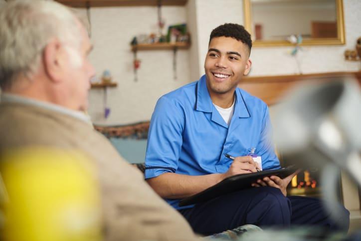 male nurse looking after elderly man