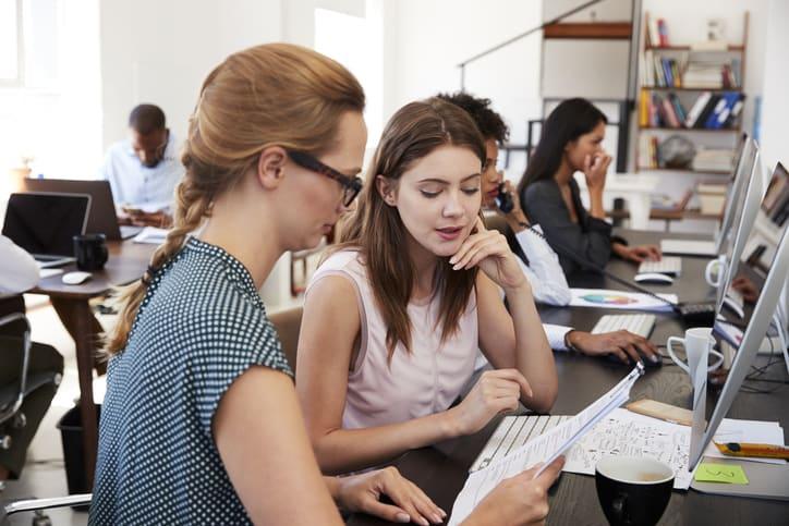 students talking through work