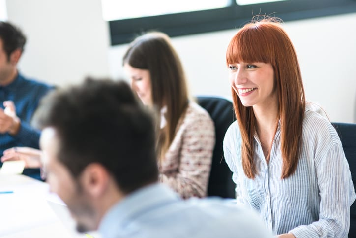 woman smiling in business meeting