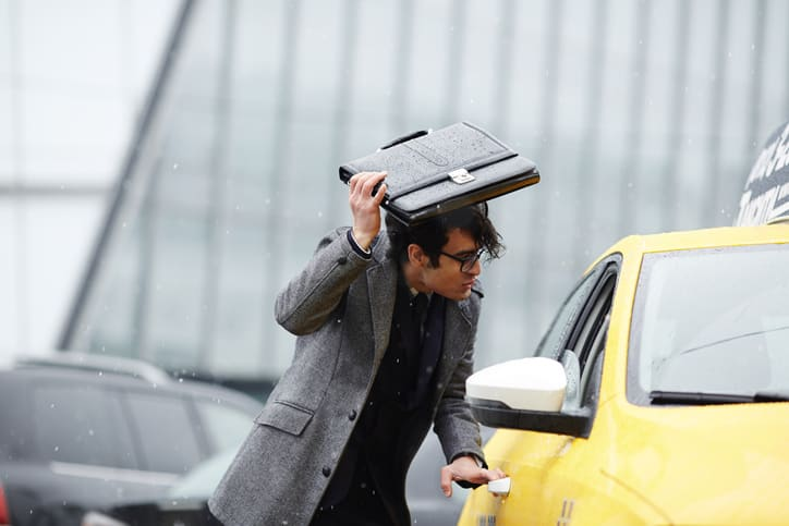 businessman getting into a taxi