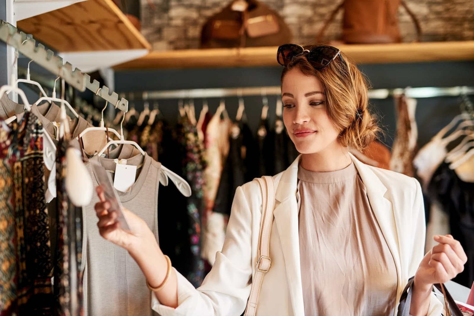 photo showing a woman happily shopping for new clothes
