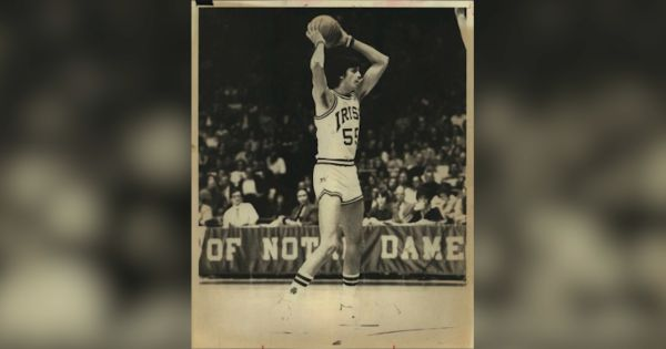 Image of Gilbert Salinas playing basketball when attending Notre Dame