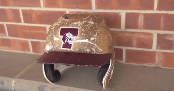 Image of Trinity Tigers baseball helmet on bench