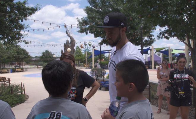 Image of Derrick White talking to kids at Morgan's Wonderland