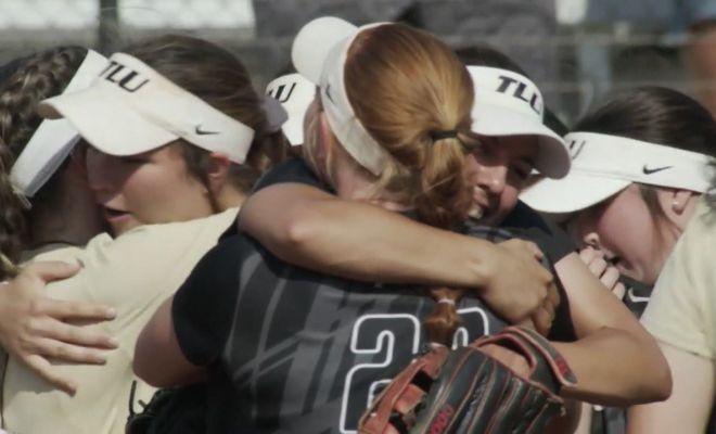 Image of TLU Softball team hugging after history win