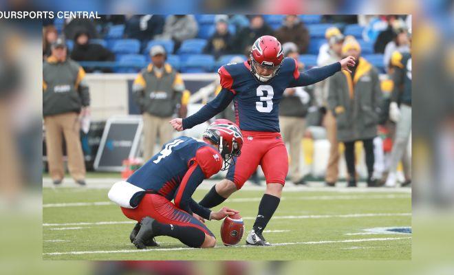 Image of Austin MacGinnis kicking field goal