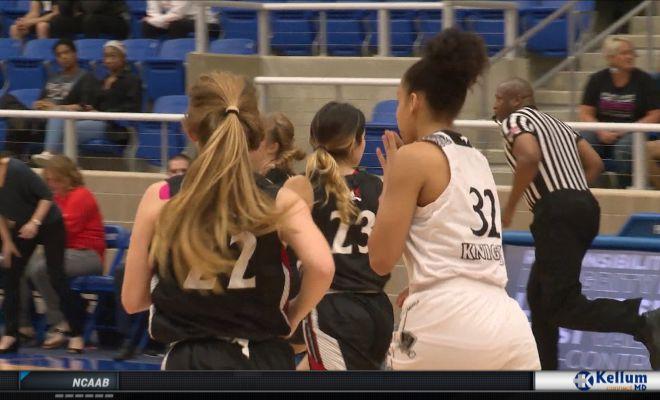 Image of Girls Basketball Players running down court