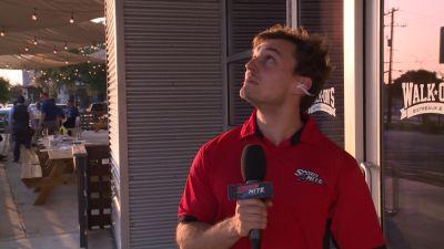 Image of Kyle Spishock looking up outside the door of Walk-On's
