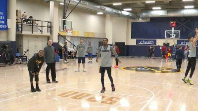 Image of Nuggets Players shooting the basketball