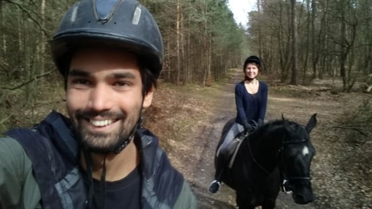 guini and balti riding in the forest