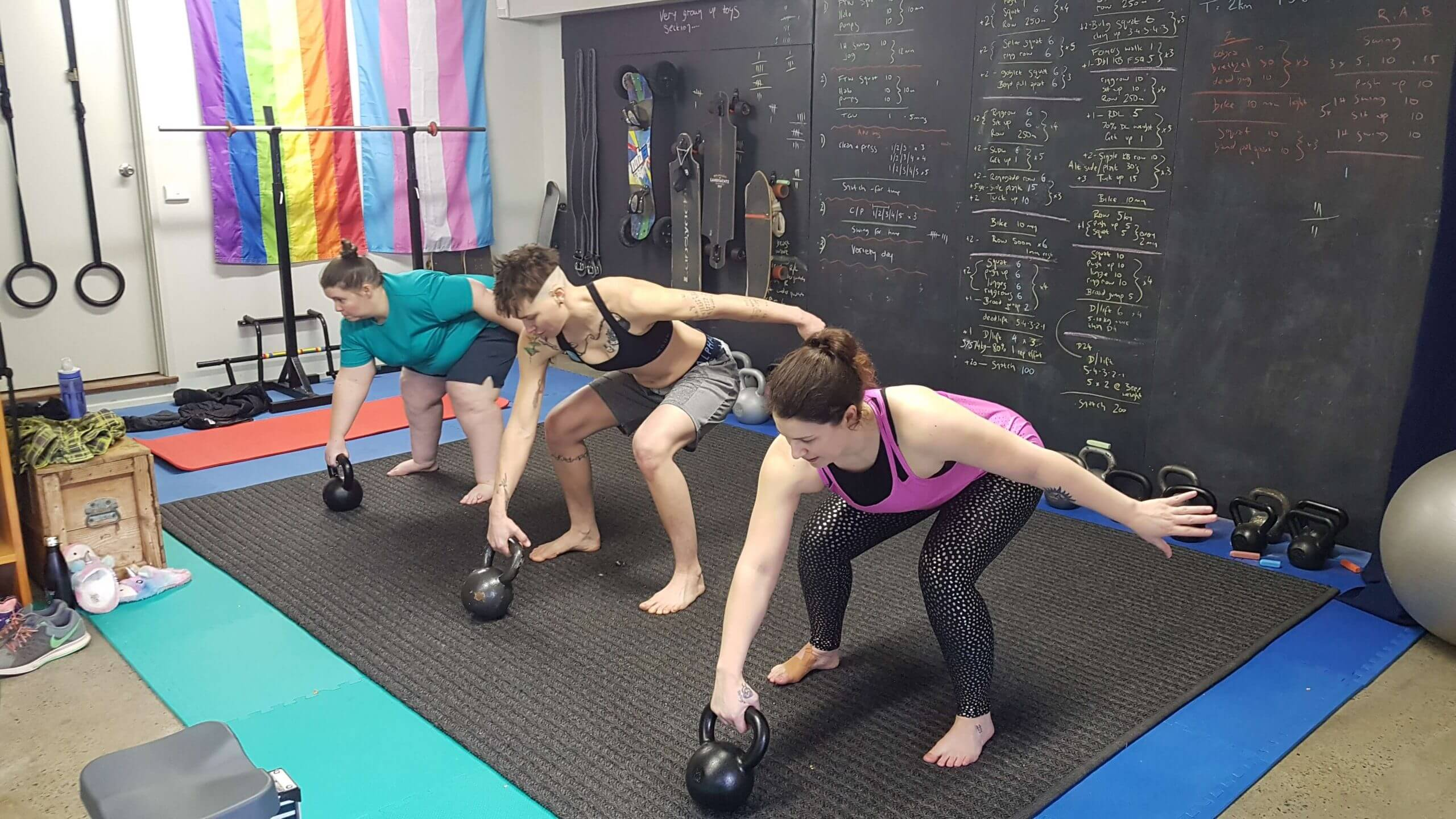 Alix Bowie and Rebecca starting a kettlebell swing during a group training session