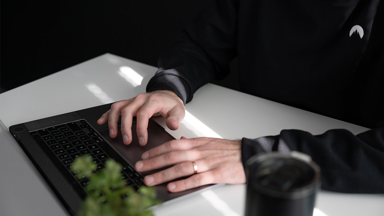 Someone debugging at their keyboard
