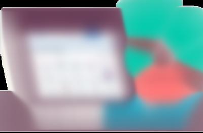 PC-skjerm med bilde av ViaTrumf sin nettside med en plante ved siden av