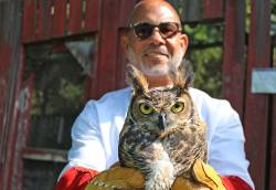 Aaron Watson, executive director of Mercer County Park Commission, holding an owl. Photo courtesy of Eleanor Horne.