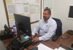 Carlos Garcia, park services coordinator for City of Bakersfield Recreation and Parks Department, in a rare moment at his desk. Photo courtesy of Dianne Hoover.