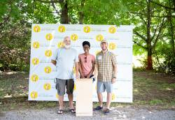 Darrell Hawks (right), founding executive director of Friends of Mill Ridge Park, presents the bat house designed and constructed for Mill Ridge Park by local students and teacher (also pictured). Photo courtesy of Darrell Hawks.