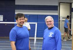 Doug Kane (right), adult sports coordinator for Whitefish Bay Recreation, with one of his badminton program participants. Photo courtesy of Anthony Iracki.