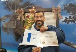 Edric Diaz, lead maintenance worker at City of Sanford, proudly holding two certifications. Photo courtesy of Robert Beall.