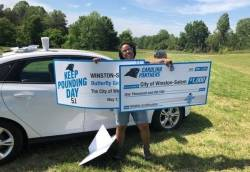Emerald P. Bowman, Sr. Special Projects Manager for City of Winston-Salem, displaying grant awards to fund the NFL-Carolina Panthers Keep Pounding Day Project Photo courtesy of Emerald P. Bowman.