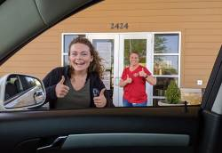 Celeste Rogers (left) and Randi Wyatt (right), of the Knapp Senior Center, providing drive-through meals to older adults during COVID-19. Photo courtesy of August Vandiver.